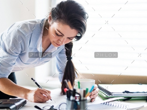 demo-attachment-172-a-portrait-of-a-woman-working-at-home-PW6FL9X